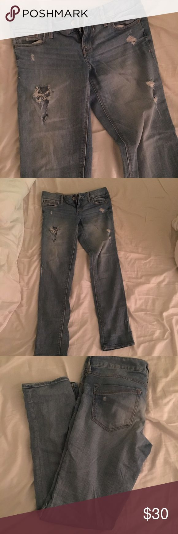 Express light wash ripped boyfriend fit jeans Ripped jeans from express, light wash denim. They're a size 0 but fit like a 2 in the waist because of the boyfriend fit. Holes in front and small rip detail on back pockets Express Jeans Boyfriend