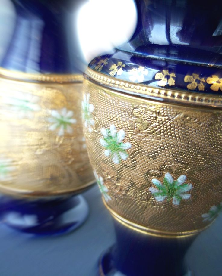 Pair of Royal Doulton Daisy Vases. Art Nouveau period. The vases have been hand decorated using the Slaters Patent technique of pressing lace fabrics into the surface of clay to create a pattern. Lovely