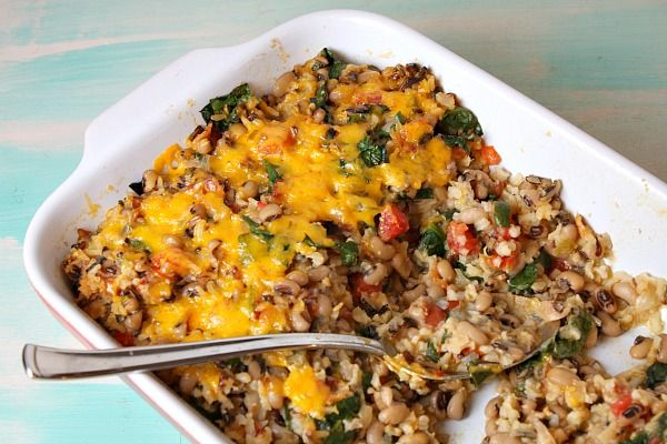 Simple Tex Mex Black Eyed Pea Casserole, comfort food New Year's dish baked with cheese, rice, bacon, spinach and tomatoes. Photographs included.