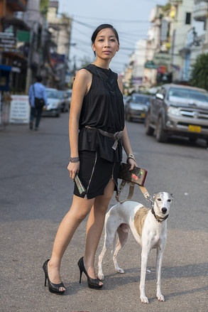 ビエンチャン(ラオス) Nam Phou Square, VIENTIANE. Mattie Do, film director. BCBG Max Azria Runway top, traditional Lao silversmith belt, Guess skirt, De Blossom shoes, Louis Vuitton clutch. Mango, whippet. Louis Vuitton collar.