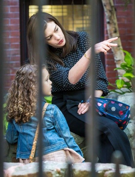 Anne Hathaway Photos Photos - Actress Anne Hathaway films a scene the set of the new movie 'The Intern' in Brooklyn, New York on June 24, 2014. In the scene, Anne looked to be dropping off her daughter at school and having a talk with her out front. Maybe she's giving her 'daughter' the same pep talk Anne (and other celebs) shared in an online video promoting girl's education. In the video, Anne said, 'It's time to unlock their potential.' - Anne Hathaway Films 'The Intern'