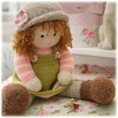 Pattern is available in both ENGLISH and DUTCH.  A little hat pattern to fit a 14 TEAROOM Doll.... (14 dolls can be found in our shop here... www.etsy.com/listing/194596190/dolls-from-the-tearoom-doll-toy-knitting)  The pattern includes the option to knit your doll hat as follows... 1.In the round and seamless 2.Flat on 2 straight knitting needles & seamed 3. A Stripy Hat (worked both ways) 4. A Crochet Flower 5. A Knitted Flower  Pattern also includes.... Details of all equipment required…
