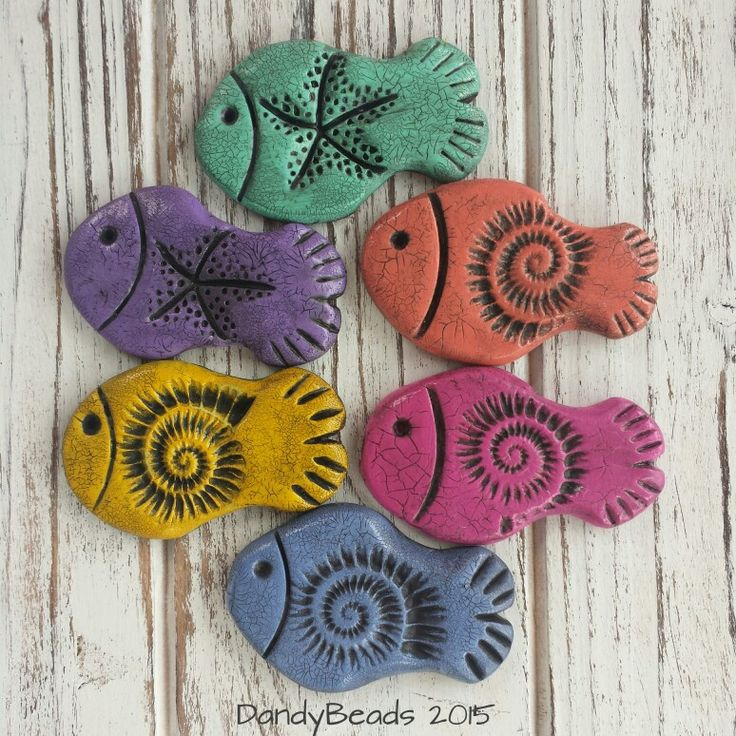 Polymer Clay Fish Pendants by Sandra Niese. Colorful and fun!