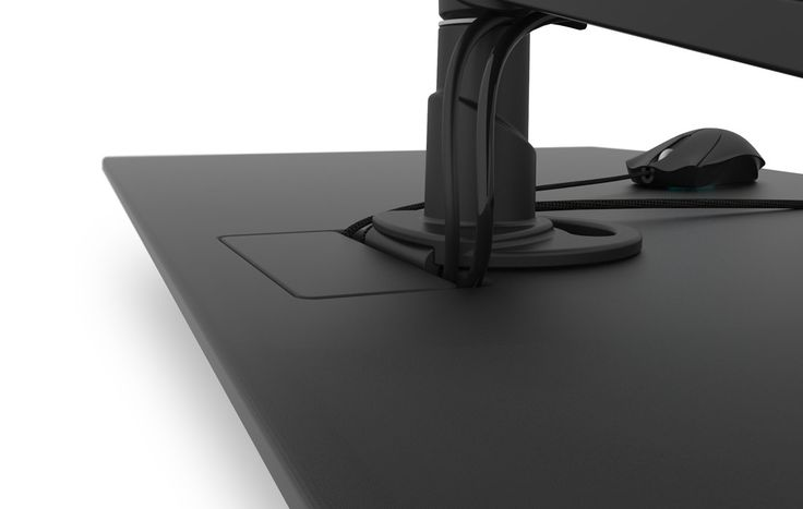 smart pass cable management gaming desk- Evodesk. Go stealth by snaking your cords through the pre-built pass through and into the hidden tray. No more tangled mess.