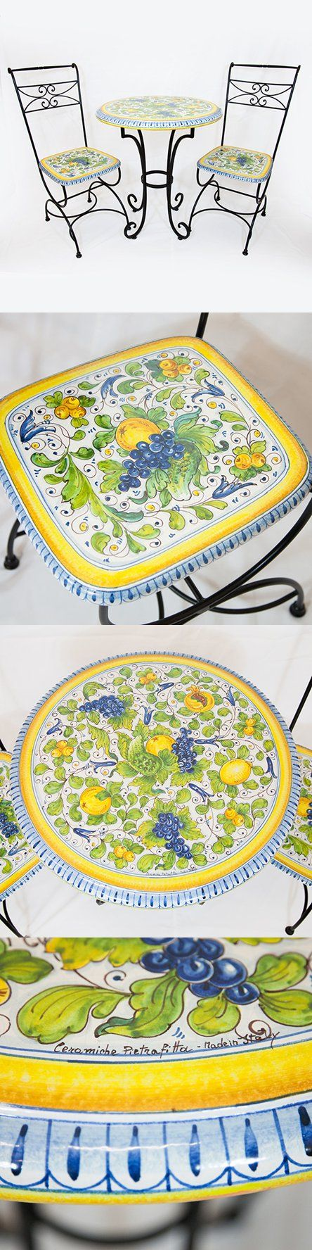 Handmade round ceramic table and chairs with lemons, pomegranates and grapes on a white background with a yellow and blue border. Click on the image to learn more about this product.