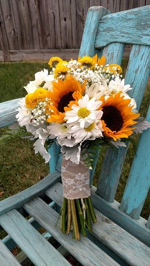 Wedding bouquet with sunflowers, daisy mums, yellow button mums and baby's breath.