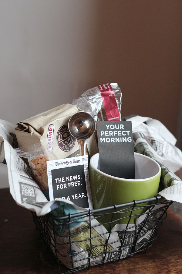 Perfect morning gift basket-- a hot beverage, mug, spoon, biscotti, bookstore giftcard or magazine/newspaper subscription, all wrapped up in a wire basket with newspaper.