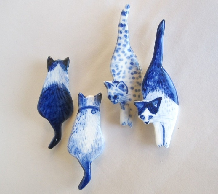 Handpainted Delft porcelain kitty brooches, by Harriet Damave