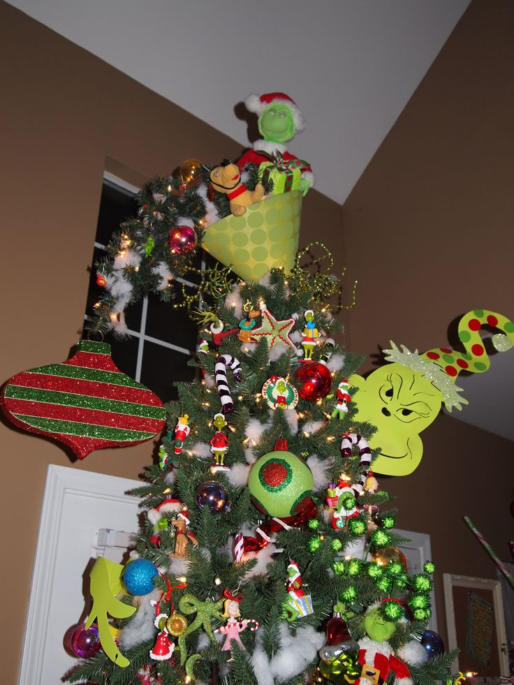 Grinch Christmas Tree Topper....upside down lampshade with one of the small outdoor pathway trees wired to make it look whimsical like the Whoville Trees