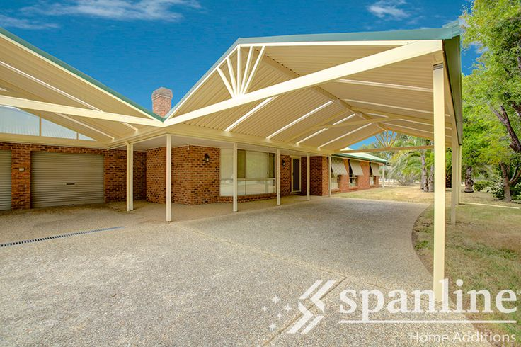 A Spanline carport or shelter creates ample shade and privacy, adding a modern, unique touch to your home.