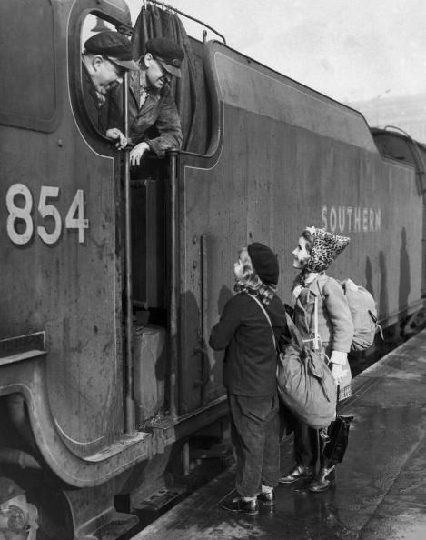 Two young evacuees chat with the engine driver and fireman of a train, before leaving London for the country during World War II, 5th November 1940. (Photo by Keystone/Hulton Archive/Getty Images)