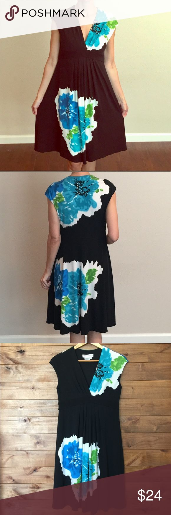 """Maggy London Black Floral V-neck Dress 10 Petite Gorgeous Floral Print on a solid black background. Green, blue and white flowers. Knee-length // V-neck // Empire waist // Perfect condition  Length: 38"""" Bust: 17"""" Maggy London Dresses Midi"""