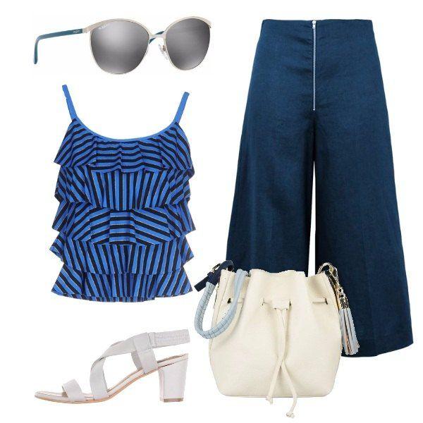 Un outfit molto pratico: veloce da indossare e comodo da portare. Il look è composto da un top in jersey a righe con balze ed un paio di pantaloni capri in lino con gamba ampia e chiusura con zip. Gli accessori danno verve all'insieme: una borsa a mano in similpelle, un paio di sandali con tacco medio e degli occhiali da sole Vogue.