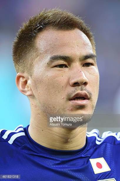 Shinji Okazaki lines up for the national anthem before the 2015 Asian Cup match between Japan and Jordan at AAMI Park on January 20 2015 in Melbourne...