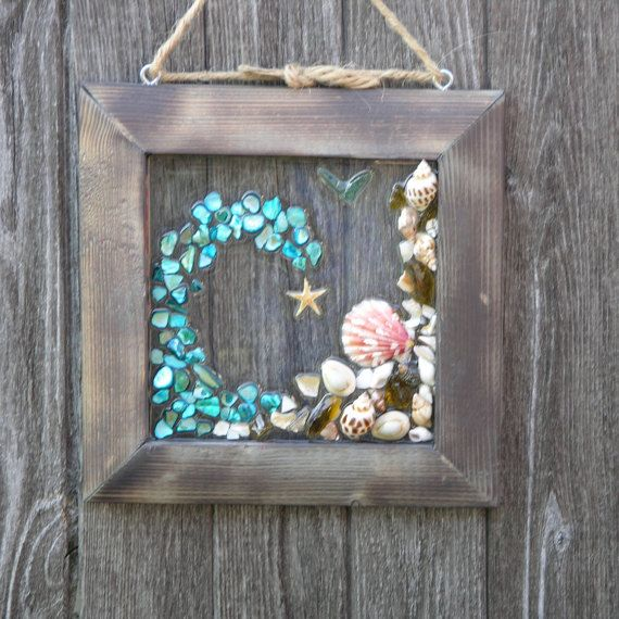 Beautiful Wave featuring turquoise mosaic & sea shells. 8 X 8 handmade rustic frame. Make an awesome gift! Looks great as a wall hanging, sun catcher or simply displayed on an easel.