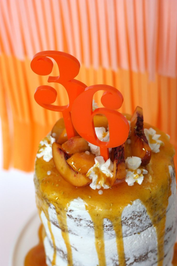 drip cake with orange number cake toppers perfect cake decoration and easy to do plus they are reusable