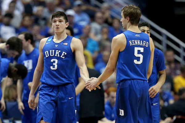 Grayson Allen Photos Photos - Grayson Allen #3 gives a five to Luke Kennard #5 of the Duke Blue Devils in the first half in the 2016 NCAA Men's Basketball Tournament West Regional at the Honda Center on March 24, 2016 in Anaheim, California. - NCAA Basketball Tournament - West Regional - Anaheim