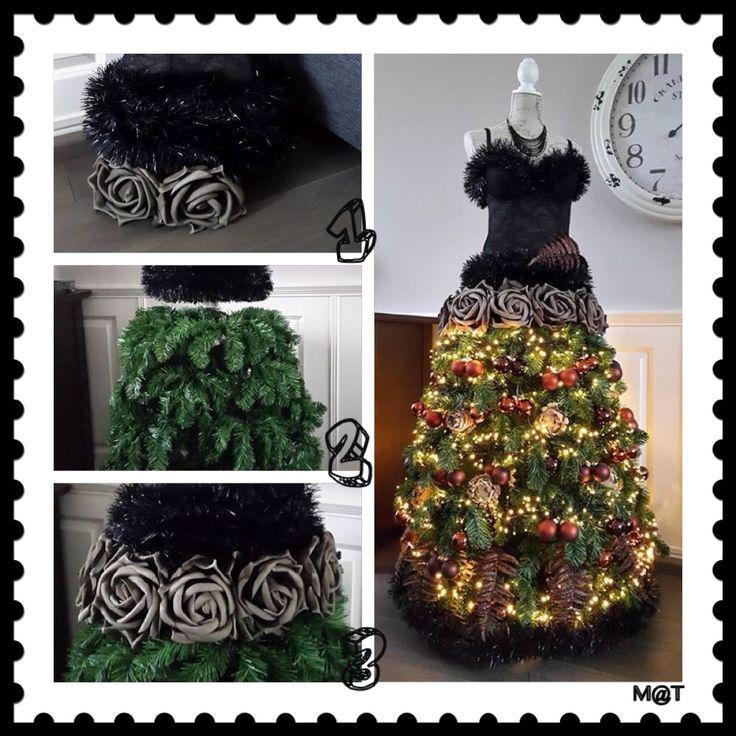 """""""kerstboom"""" paspop gemaakt van borst van paspop,  stukje bezemsteel voor in kerstboom en paspop,  en het middelste gedeelte van een kunstboom. Takken naar beneden doen voor de rok.."""