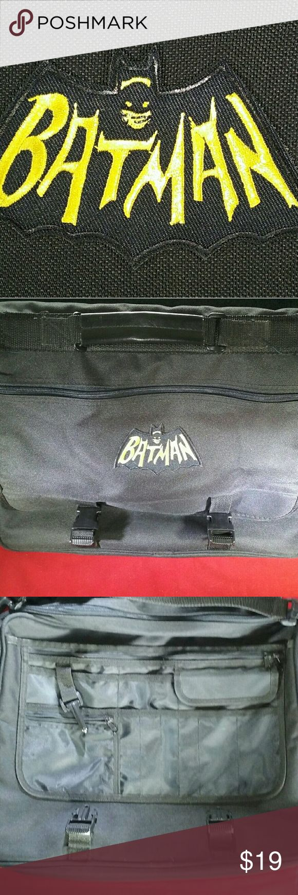 "Batman Canvas Messenger Bag Black canvas messenger bag with retro Batman patch * Adjustable shoulder strap * Zippered pocket in flap * Multiple pockets/sleeves for pens, change, keys, sundries, etc. * Large interior space fits laptop, tablet, file folders, etc. * Measures 15.5"" x 11.5"" x 4"" * Side zipper allows it to expand to 15.5"" x 11.5"" x 6"" Bags Messenger Bags"