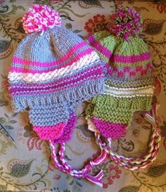 Free Knitting Pattern for Scrap Happy Hat - Colorful earflap hat perfect for scrap yarn. Knit 2 strands of worsted weight yarn doubled throughout the project. Designed by Susan B. Anderson. Rated easy by Ravelrers
