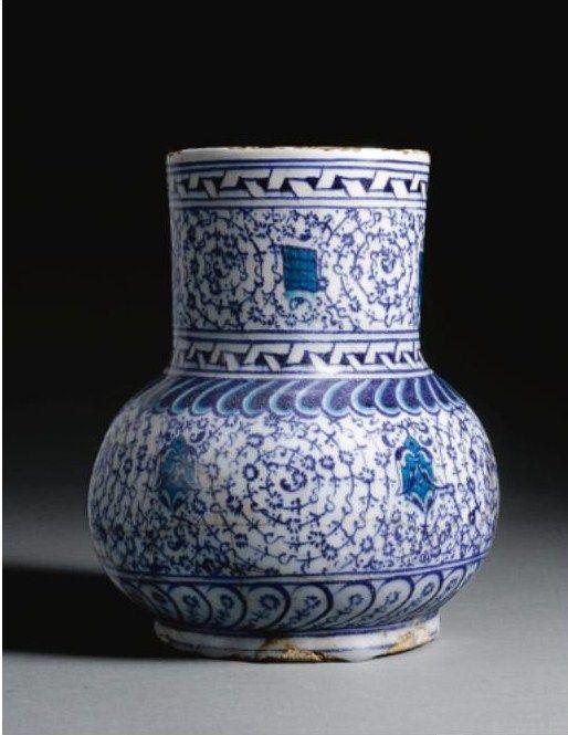 A rare Iznikblue and white'Golden Horn' jug, Turkey, circa1530-40