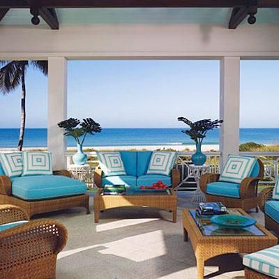 Designer Anthony Baratta outfitted a covered porch overlooking turquoise seas off the Florida coast simply, with wicker furniture from the Oscar de la Renta collection, geometric pillows, and cushions in his favorite sky blue hue. Coastalliving.com