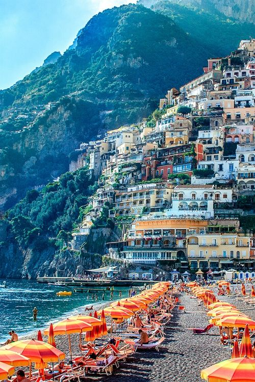 Positano, #Italy. Positano's main beach is one of the liveliest and most cosmopolitan of all those on the Amalfi Coast.
