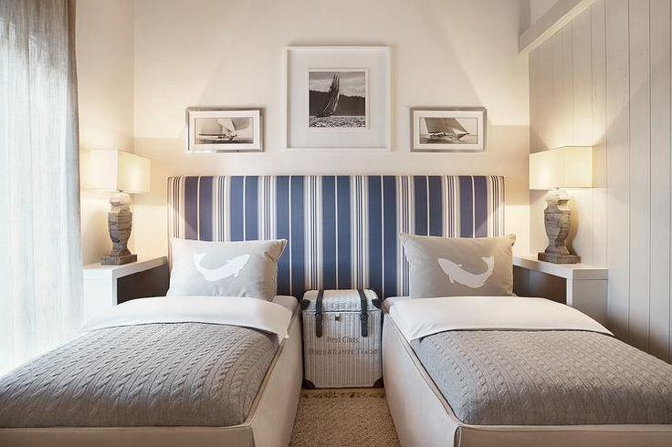 Narrow built in shelf flanking beds for lighting