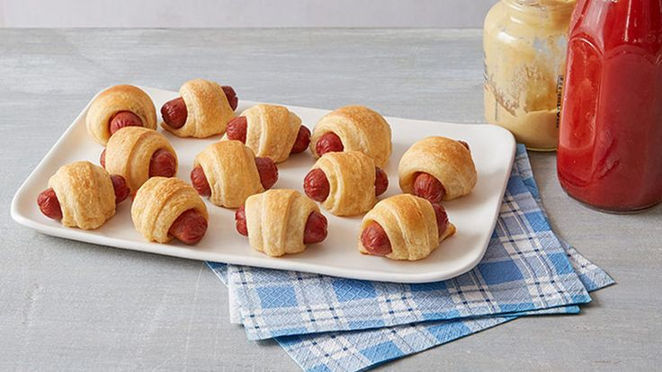 Pigs in a Blanket - Mini sausages are all wrapped up in flaky crescents in an all-time favorite appetizer.