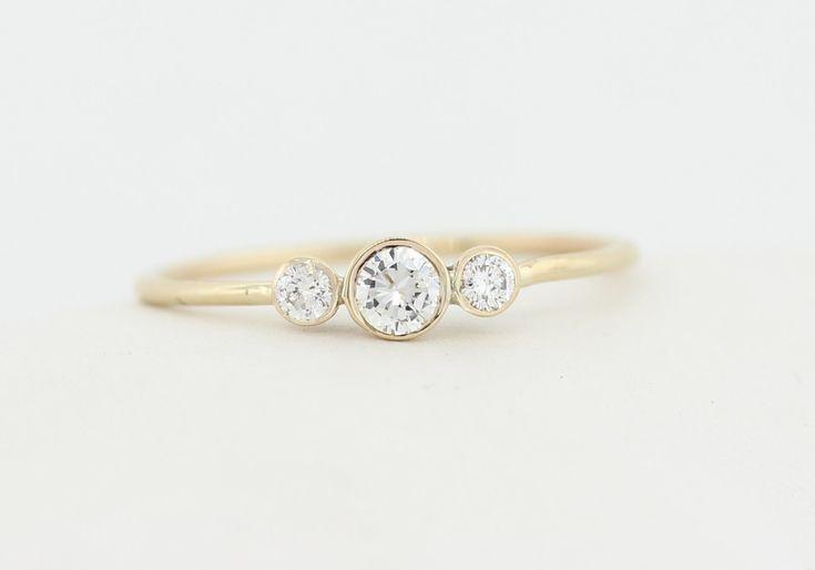 Three Stone Round Brilliant Cut Diamond Engagement Ring, Thin 3 Stone Dainty Bezel Set Engagement Ring, Three Stone Bezel Diamond Ring by MichaelGabriels on Etsy https://www.etsy.com/listing/230989242/three-stone-round-brilliant-cut-diamond