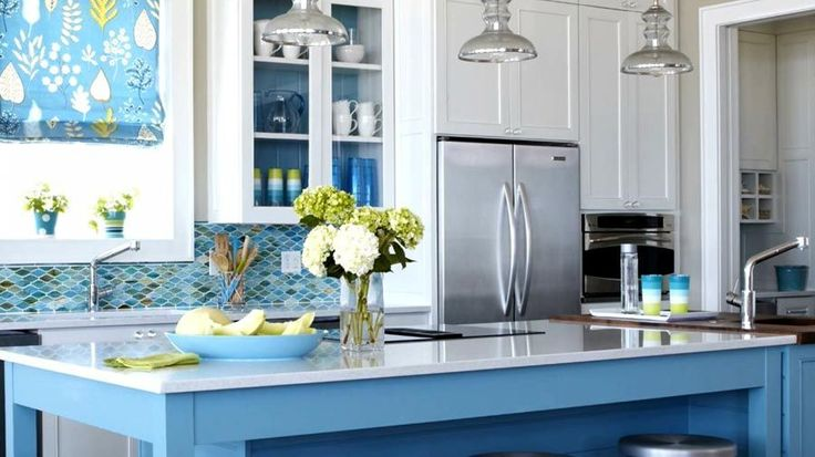 We break it down with our top white paint colors for kitchen cabinets.