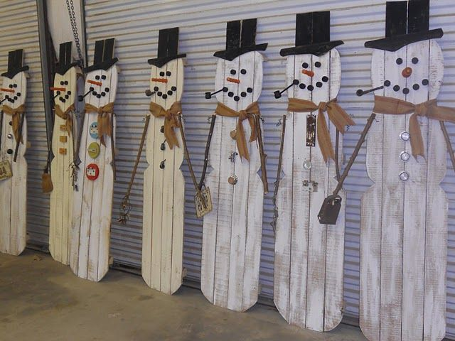 Repurposed Frosties~ What mixes best with snowmen?  Old spools for the carrot noses. Vintage burlap webbing for scarves. License plates. Gear shift knobs. Cheese graters. Hinges. Keys, etc.