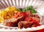 Southwestern Meat Loaf     ingredients    1 slightly beaten egg  3/4 cup soft bread crumbs (1 slice bread)  3/4 cup salsa  1/3 cup raisins  1/4 cup finely chopped almonds, toasted  1/4 cup finely chopped onion  1/2 teaspoon sugar  1/2 teaspoon salt  1/4 teaspoon ground cinnamon  1/8 teaspoon ground cloves  1-1/2 pounds lean ground beef  1/4 cup salsa  Salsa (optional)    directions    In a large bowl stir together the egg, bread crumbs, the 3/4 cup salsa, the raisins, almonds, onion, sugar…