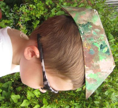 camouflage hat craft. Meh. This went over okay... A few kids were mad that the hat wouldn't stay on their heads. Our age group didn't really understand the concept of camouflage either. Would prob work well with older toddlers