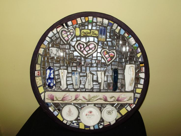 Coffee time tray - an old tray covered with tiles, broken mug handles,and mirror and other bits.