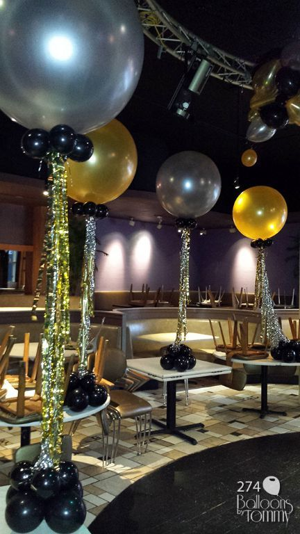 Silver, gold and black New Year's Eve balloon bouquets with coordinating metallic ribbon   Balloons by Tommy   #balloonsbytommy