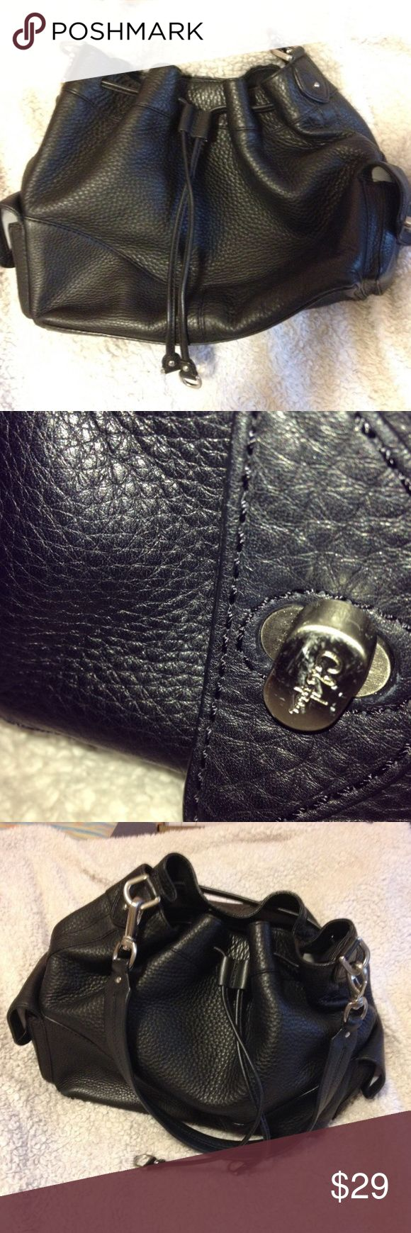 Cole Haan black pebble leather bucket-style hobo Cole Haan black pebble leather bucket-style purse, drawstrings, gently used,  2 exterior pockets  Height- 11 inches Width- 16 Inches Depth- 6 Inches Cole Haan Bags Hobos