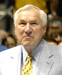 """Dean Edwards Smith (February 28, 1931 – February 7, 2015) was an American head coach of men's college basketball. Originally from Emporia, Kansas, Smith was called a """"coaching legend"""" by the Basketball Hall of Fame. Smith was best known for his 36-year coaching tenure at the University of North Carolina at Chapel Hill. Smith coached from 1961 to 1997 and retired with 879 victories,"""
