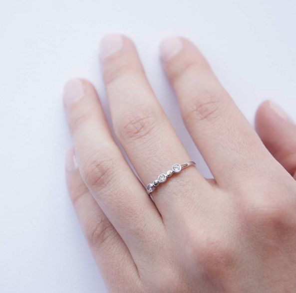 Dainty 3 Stone Ring: Subtle design of this ring is easy to wear and will accentuate your romantic and elegant side. Dainty cubic zirconias set in a rub over design. $65.00