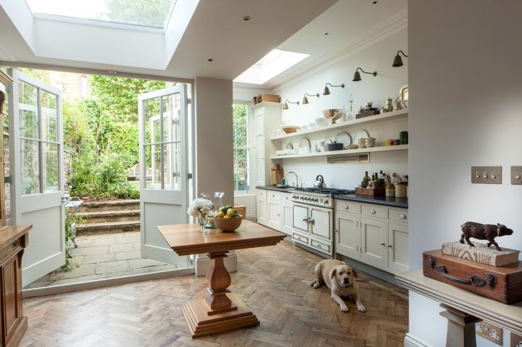 The kitchen is placed in the extra space created by interior designer Justin Van Breda extending into the side return