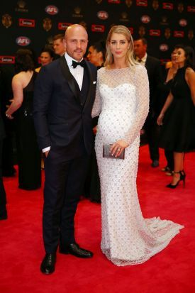 Nathan Jones of the Melbourne Demons and Jerri Jones pose on the red carpet ahead of the 2016 AFL Brownlow Medal count ...