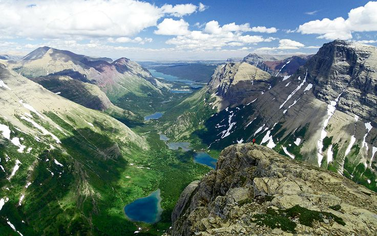 Glacier National Park Trip Ideas | swiftcurrent mountain with many glacier hotel in the distance