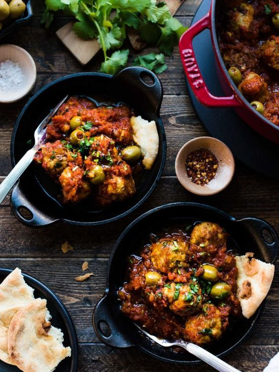 Albóndigas with Olives in tomato sauce is a classic Spanish meatball dish with a twist that olive lovers will love. Perfect for tapas, as an appetizer, or a hearty meal on its own, you will love this easy albóndigas recipe! #sponsored #haveanoliveday #olivesfromspain #meatballs #olives #albondigas