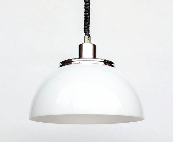 Very retro and atomic piece of ceiling lighting straight from the space age era of the 1970s. Its white shade with a chrome fixture really