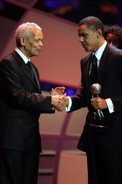 Julian Bond presents Senator Barack Obama with the Chairman's Award on stage at…