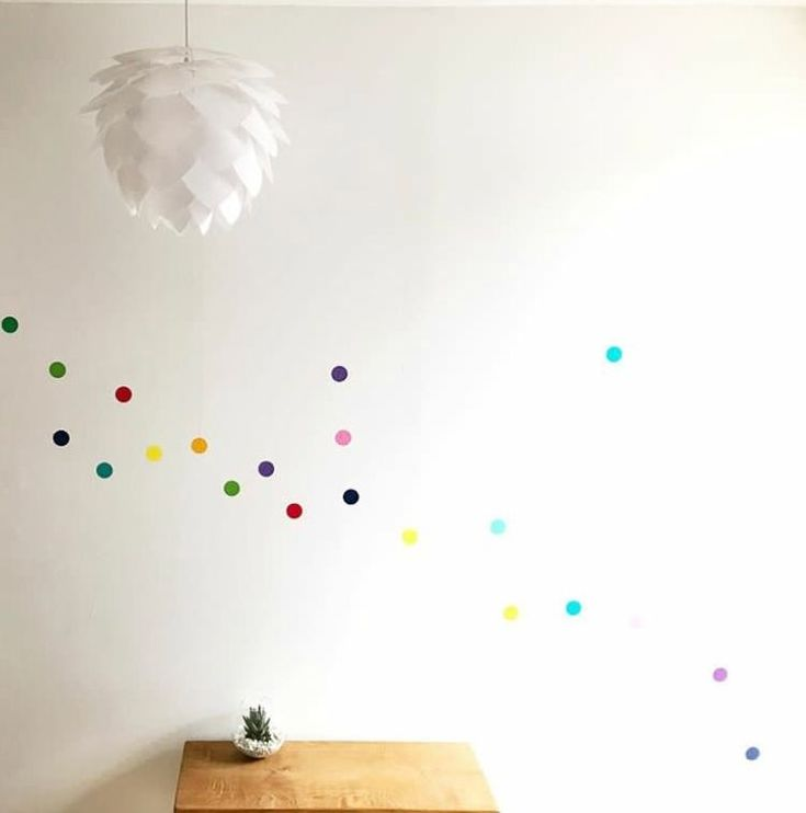 Colourful dots contrast with the white Silvia lampshade in this fun image by @ullikat.