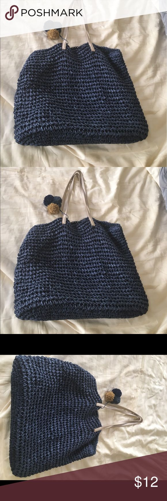 Beach bag Navy woven beach bag with tassels and silver handle - gently used paper/poly mix- inside perfect no stains no smell Bags Totes