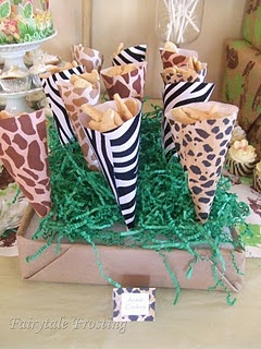 Safari themed baby shower party favors. Complete the feel of this theme with gifting a Little Me http://www.littleme.com/safari-footie/