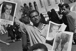 Newspaper vendor with Gamal Abdel NASSER's picture during Nasser funeral.