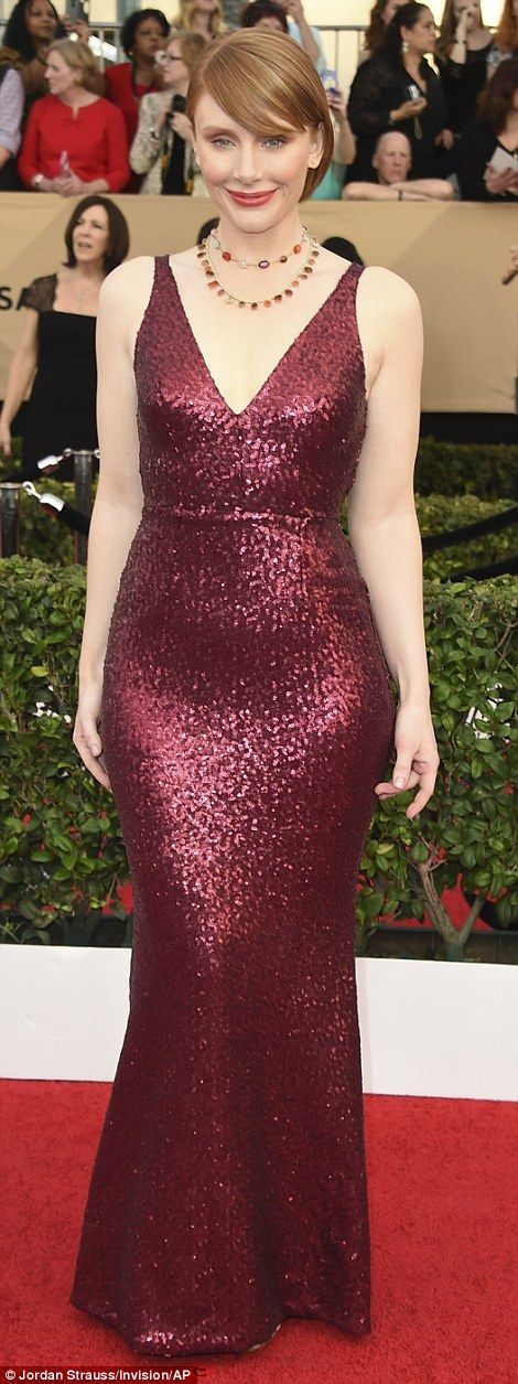All that glitters: Bryce Dallas Howard looked sensational in a ruby red Dress the Populati...
